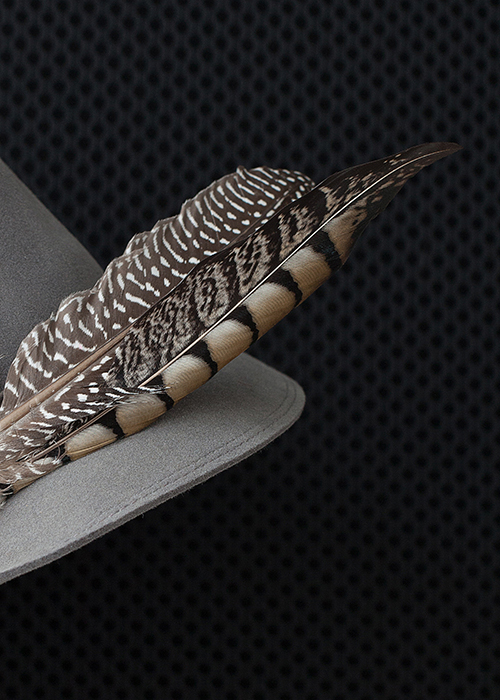 61cbe8ae Trendy greyish feathers combined with a 3D printed cap.